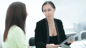 Close up. two business women discussing documents royalty free stock photo