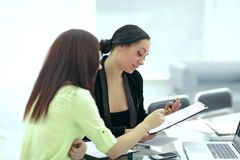Close up.two business women discussing financial documents stock image