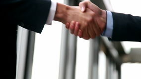 Close up of two businessman shaking hands. In office stock video footage