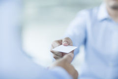 Close up of two businessmen exchanging business cards Royalty Free Stock Photo
