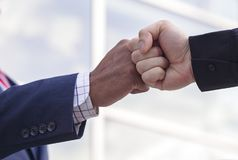 Close-up of two businessmen giving fist bump. For friendship or success Royalty Free Stock Photo