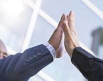 Close-up of two businessmen giving fist bump. Partnership concept. Close-up of two businessmen giving fist bump for partnership or agreement stock photo