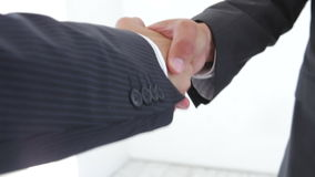 Close Up Of Two Businessmen Shaking Hands. Against a white background.Shot on Canon 5D MkII at 25fps stock video