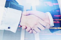 Close up of two businessmen shaking hands royalty free stock image