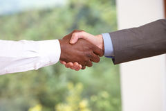 Close Up Of Two Businessmen Shaking Hands Royalty Free Stock Photos
