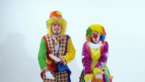 Close-up of two circus clowns dancing together mostly with their hands stock video