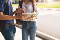 Close up of two college student discussion with tablet. Girl holding books talking to boy in university or school. Education and. Lifestyle learning. Technology stock photos