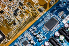 Two old colourful circuit boards. Close up of two different computer circuit boards with components Royalty Free Stock Photography