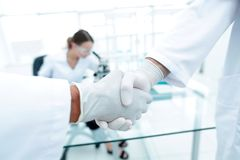 Medical gloves make shaking hands Royalty Free Stock Photography