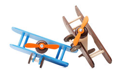 Close-up of two eco-friendly colorful airplanes for kids games, isolated on a white background. Wooden airplane models. Stock Photography