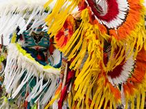 Close Up of Two Fancy Dancers with Feathered Headdreses and Bustles at a Pow Wow. Close up of two Native American men fancy dancers wearing feather and quill royalty free stock photography
