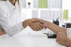 Close up of two female business partners shaking hands Stock Photos