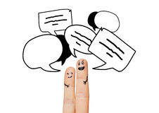 Close up of two fingers with communication clouds. Communication, family, couple, people and body parts concept - close up of two fingers with different facial Royalty Free Stock Photography