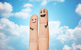 Close up of two fingers with smiley faces Stock Photo