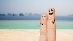 Close up of two fingers with smiley faces Royalty Free Stock Photography