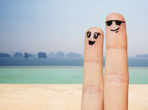 Close up of two fingers with smiley faces Stock Photography