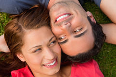 Close-up two friends looking at each other while lying head to s Royalty Free Stock Photo
