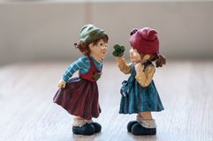 Close-up of two garden gnomes. On a wooden table. Gnomes talking royalty free stock photo