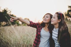 Close up of two girls. Close friends in field with sunset background. Freedom enjoy together. Vintage filter style. Happy friends royalty free stock photos