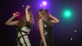 Close-up of two girls dancing in disco style. Slow motion stock video