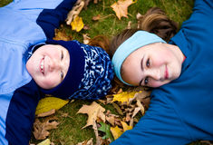 Close up of two girls laying on ground Royalty Free Stock Photo