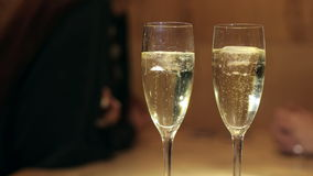 Close-up of two glasses of champagne with ice. stock video