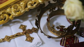 Close up of two gold wedding crowns.  stock footage
