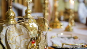 Close up of two gold wedding crowns. HD stock video footage
