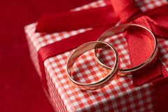 Close-up of two gold Wedding rings and Gift box Royalty Free Stock Photography