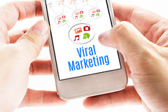 Close up Two hand holding smart phone with Viral Marketing word. And icons, Digital concept Stock Photo