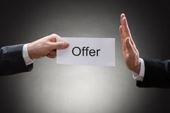 Close-up of two hand's holding offer paper Royalty Free Stock Image