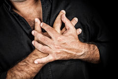 Close up of two hands grabbing a chest Stock Image