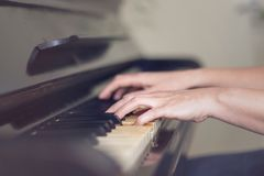 Close up of two hands playing piano, shallow focus. Close up of two female hands playing piano, shallow focus royalty free stock image