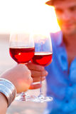 Close-up of two human's hand with wineglasses red wine during Royalty Free Stock Photo