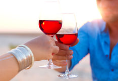 Close-up of two human's hand with wineglasses red wine during Royalty Free Stock Images