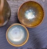 Close-up of two Japanese shells for sake on a slate plate stock image