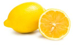 Close up of two lemons and one is cut Royalty Free Stock Images