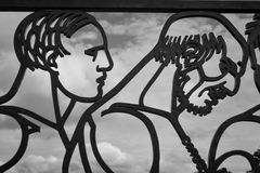 Close-up - two men in the fence - The Vigeland Park, Oslo Stock Photo