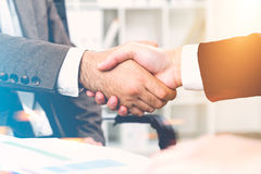 Close up of two men shaking hands in office Royalty Free Stock Photos