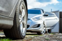 Two modern cars parked in country close royalty free stock images