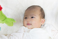 Close - Up Two month old new born asian cute baby playing on pla Royalty Free Stock Photography