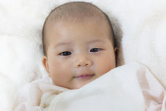 Close - Up Two month old new born asian cute baby smile rests ha Royalty Free Stock Photo
