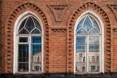 Old windows  in  house. Close-up of a two  old windows  in old house a mansion made of old brick Royalty Free Stock Photography