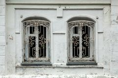 Close-up of a two old windows in old house. Close-up of a two  old windows  in old house a mansion made of old  white brick Royalty Free Stock Photography