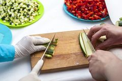 Hands cutting zucchini royalty free stock image
