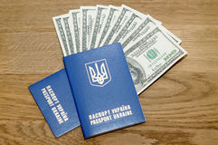 Close up of two  passports and cash money on a wooden table Stock Photo