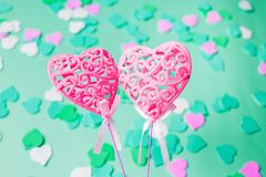 Close-up of two pink hearts on a turquoise background royalty free stock image