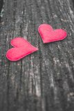 Close up of two red hearts on old rustic wooden background stock images