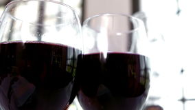 Close-up of two red wine glasses stock footage