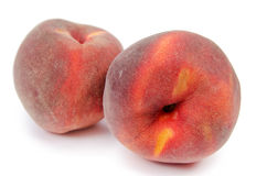 Close up of a two ripe peaches Stock Photos
